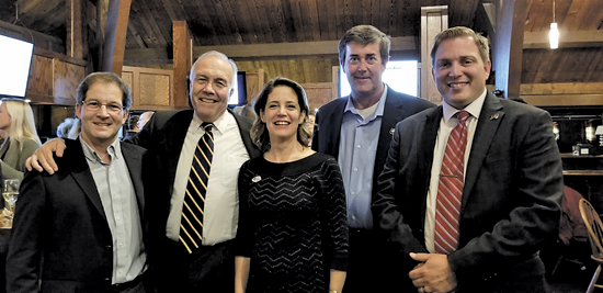 Victorious Republicans met at their election night get-together at Ellden's Grill & Banquet Tuesday. The GOP swept all the Island races in the general election. From left, Town Justice-elect Mark Nemeth, Town Supervisor-elect John Whitney, re-elected Town Clerk Pattie Frentzel, re-elected Councilman Mike Madigan, Councilman-elect Tom Digati.