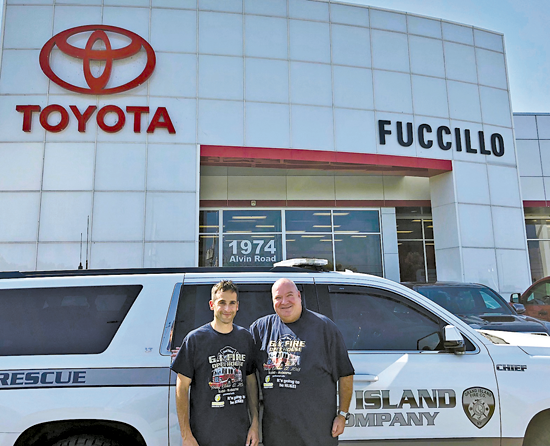 Grand Island Fire Chief Chris Soluri, left, is pictured with Mike Kelly, the general manager of Fuccillo Hyundai and Fuccillo Toyota on Alvin Road, wearing fire prevention week T-shirts.