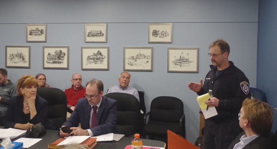Matt Osinski of the Grand Island Fire Co. addresses the Town Board on the issue of fire hydrants in the town. (Photo by Larry Austin)