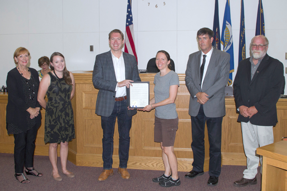 To support of the 100th year anniversary of the Migratory Bird Treaty Act, the Town Board of Grand Island proclaimed 2018 as the `Year of the Bird` on Grand Island. At its meeting Tuesday in Town Hall, the board noted the town is home to `some of the most critical land and water resources in the Niagara River corridor that provide effective and life sustaining stewardship for the bio-diverse avian community.` In making the proclamation, the board said the Niagara River corridor has been officially designated a Globally Important Significant Bird Area on the basis of its biodiverse habitat that supports more than 300 different bird species. Further, the proclamation stated the town's nearshore waters and wetlands together with unique habitats of the Niagara River are critical to the life cycles and survival of native and migrant species including neo-tropical birds, shorebirds, colonial wading birds, waterfowl and birds of prey. Pictured, Island resident Nicole Gerber accepts the proclamation from council members Bev Kinney, Jennifer Baney, Town Supervisor Nathan McMurray, and council members Mike Madigan and Pete Marston. (Photo by Larry Austin)