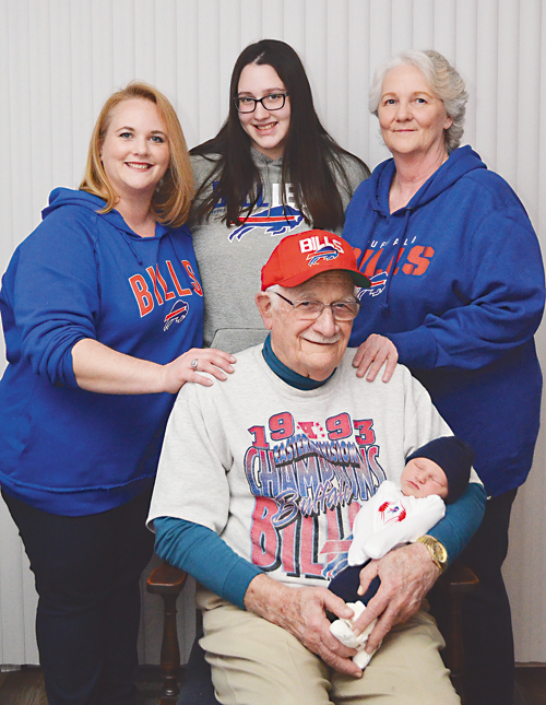 A five-generation photo of Bob Goulding's family shows an age range from 1 month to 90 years old. Everyone is wearing their Bills colors to cheer the team on during the season. Goulding is seated with his great-great-grandson, Wyatt Nicholas Lancaster. Standing, from left, family members are: Goulding's granddaughter, Kim Pressley; Kim's daughter, Kayla Pressley, who is Wyatt's mother; and Goulding's daughter, Kathy Shonitsky, who is Kim's mother. (Submitted photo)