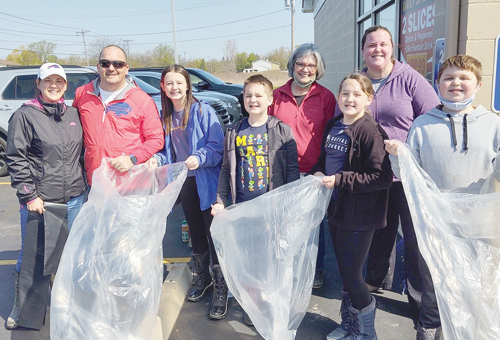 Part of the Chamber of Commerce team cleaning Stony Point Road and Ransom Road. From left, Alicia, Eric, Danika and Anthony Fiebelkorn; Kathi James, Molly Fiebelkorn, Megan MacConkey and Andrew MacConkey (Photo by Michael J. Billoni)
