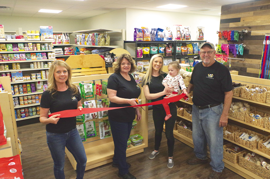 Island Pets and Feed held a ribbon-cutting for their location in the new plaza at 2099 Grand Island Blvd., Suite C. From left: Julie Dee, Lynda Gieselman, Samantha and Taylor Bidell, and Dan Gieselman. (Photo by Larry Austin)