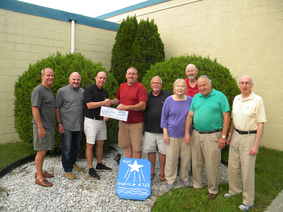 Pictured, from left: Knights Frank Burkhart and Mike Ficorilli; accepting the donation is Dick Crawford, past president of the Lions, Sean Carroll, grand knight; Knight Gary Golembiewski, event chairman; and Lions Annette Lobl, Dave Chervinsky, Henry Lobl and Paul Bassette.