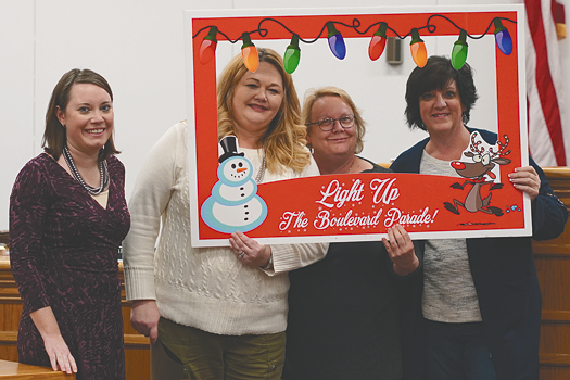 Grand Island Chamber of Commerce directors Jenn Pusatier, Sue Berger and Diana Nobumoto promote the Light Up the Boulevard Parade during the Grand Island Town Board meeting. Pictured at left is Councilwoman Jennifer Baney. (Photo by Larry Austin)