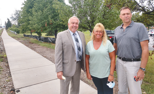 From left, Town Supervisor John C. Whitney, Assistant Civil Engineer Lynn Dingey, and Town Engineer Robert Westfall on the sidewalk in front of Town Hall.