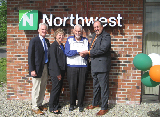 Northwest Bank presented a grand prize in its $25,000 Home Makeover Sweepstakes. Pictured, from left: Richard C. Hamister, senior vice president and New York region president; Theresa Vertalino, senior vice president and central district manager, New York region; Albert Hujer, contest winner; and Michael Samland, vice president, Grand Island office manager, presenting the prize.