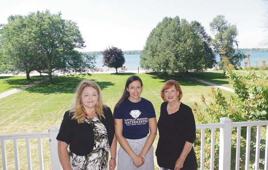 Jennifer Pusatier, Elizabeth Robbe and Beverly Kinney, organizers of the Paddles Up Summerfest, are pictured on the patio of the Falconwood, site of activities that are part of the expanded Paddles Up event. (Photo by Larry Austin)