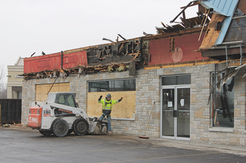 Mulvey Construction of Lockport, general contractor on the renovation of the entire Town Hall Square Plaza, gets to work Thursday on demolishing portions at the northern end of the plaza that were damaged by a November 2019 fire at Tai Pei Chinese Restaurant. The restaurant will reopen once it completes interior decorations and the installation of new equipment. The project, targeted for completion May 1, will include a new façade from the windows up. (Photo by Karen Carr Keefe)