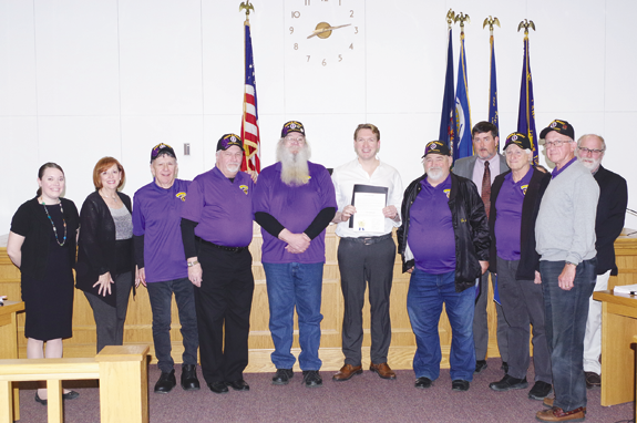 The Grand Island Town Board issued a proclamation to members of the Military Order of the Purple Heart Chapter 187 Monday at Town Hall. Pictured above, from left: Councilwomen Jennifer Baney and Beverly Kinney; Dan Morano, Jim Schaller, Gary Payne; Town Supervisor Nathan McMurray, Chapter Commander Kenneth Speaker, Councilman Mike Madigan, Russ Ward, Tom Mach, and Councilman Peter Marston. (Photos by Larry Austin)