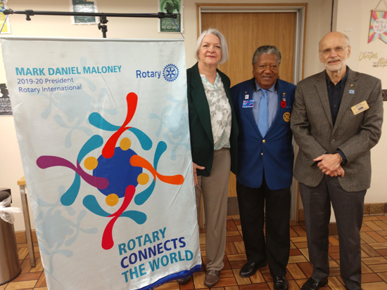 From left, Sherry Miller, president-elect of Rotary Club of Grand Island; Artis, and Richard Earne, Rotary Club of Grand Island president.