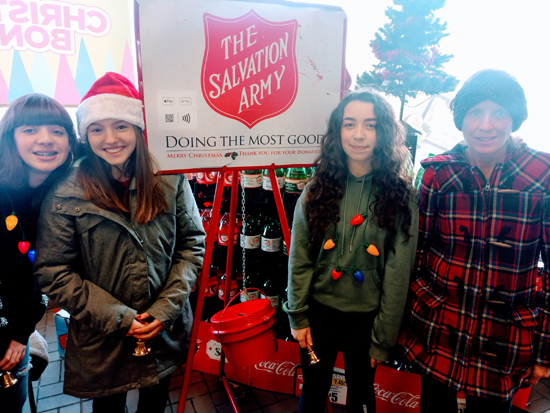 From left, Grand Island High School sophomores Khloey Ellis, Renee DiLaura, Ava Todaro and volunteer Debbie Billoni are Red Kettle Campaign volunteers at Tops Market.