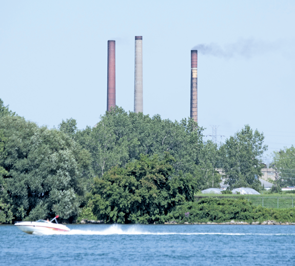 Smoke billows out of a Tonawanda Coke smokestack Thursday afternoon as seen from Ferry Village. (Photo by Larry Austin)