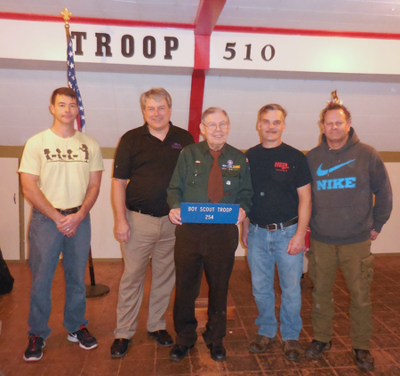 Hal Pierce, center, is flanked by past Boy Scouts of Troop and Post 254 who returned to celebrate the 40th anniversary of coin sorting for UNICEF. Alumni taking part were, from left, John Lockett and Rob Nichols; and Tim Wilkinson and Steve Gushue. Pierce put them to work (below), sorting thousands of coins `into my metal coffee cans that I haul up out of the cellar once a year.`