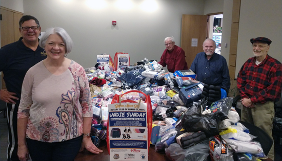 From left, Rotarians Mike Billoni, Sherry Miller (president-elect), Hank Kammerer (secretary), Dan Flaim (treasurer) and Dick Earne (president) sort the donations to Undie Sunday.