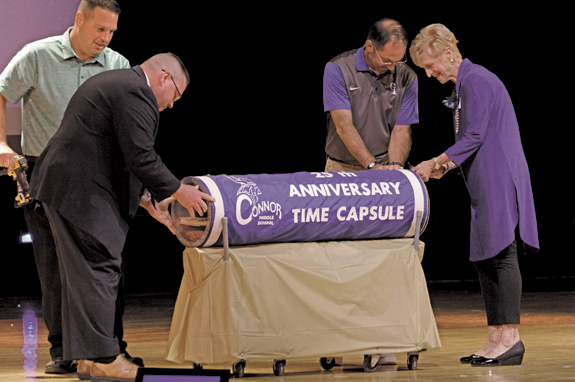 Current Veronica Connor Middle School Principal John Fitzpatrick and past principal Agnes Becker open a time capsule sealed 25 years ago. Below, teachers partied like it was 1968 during the 50th anniversary celebration of Connor Middle School. (Photos by Larry Austin)