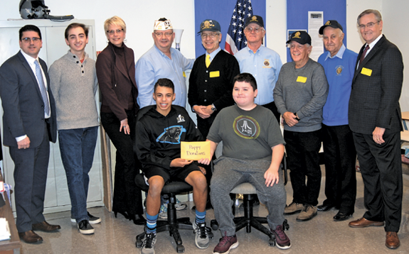 Standing, from left: Connor Assistant Principal Max Pikula, Boy Scout Ryan Wellence, teacher Dawn Hayes; veterans Alan Lee, Peter Kuszczak, Ray DeGlopper, Robert Haag, Al Prame and Jim Sharpe. Seated, from left: middle school students Joey Fatta and Josh Wozniak. (Photo courtesy Jodi Robinson)
