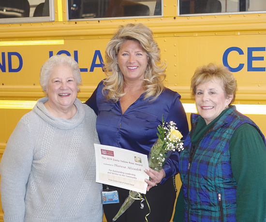 Andrea Moreau, left, and Sue Brusino of the Zonta Club of Grand Island presented a Yellow Rose award to Theresa Alizadeh, transportation supervisor for the Grand Island Central School District. Below, they presented another Yellow Rose to Ellen DeNormand of Momma De's Mixing Bowl. (Photo by Larry Austin)