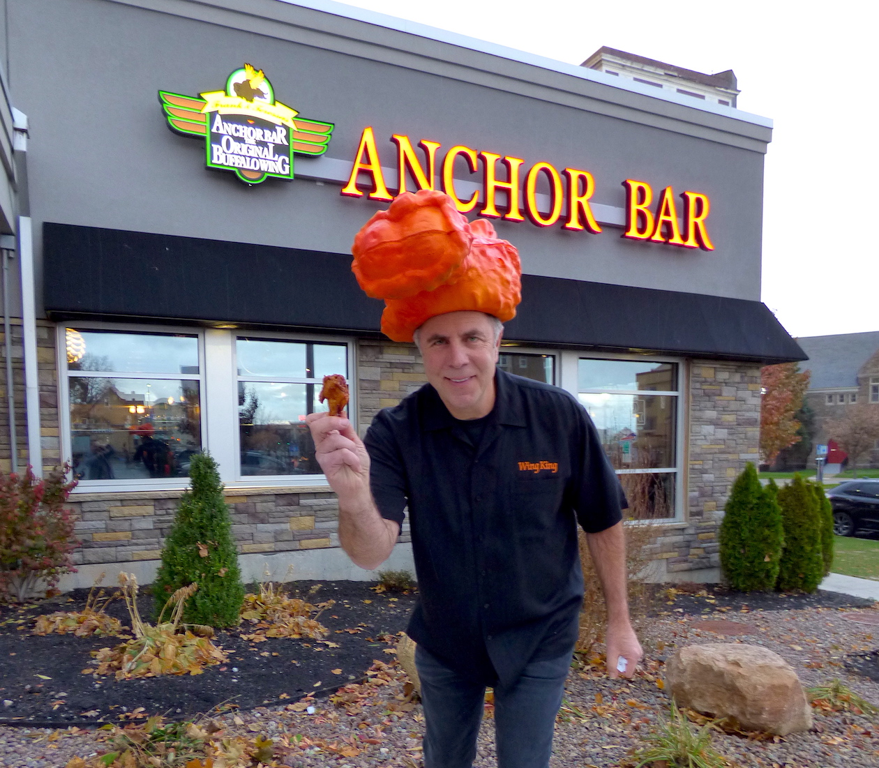 `Wing King` Drew Cerza stands in front of the new Anchor Bar location.
