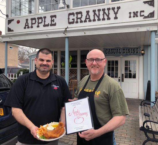 Apple Granny owners Chuck Barber and Michael Burke are shown with their award-winning fish.