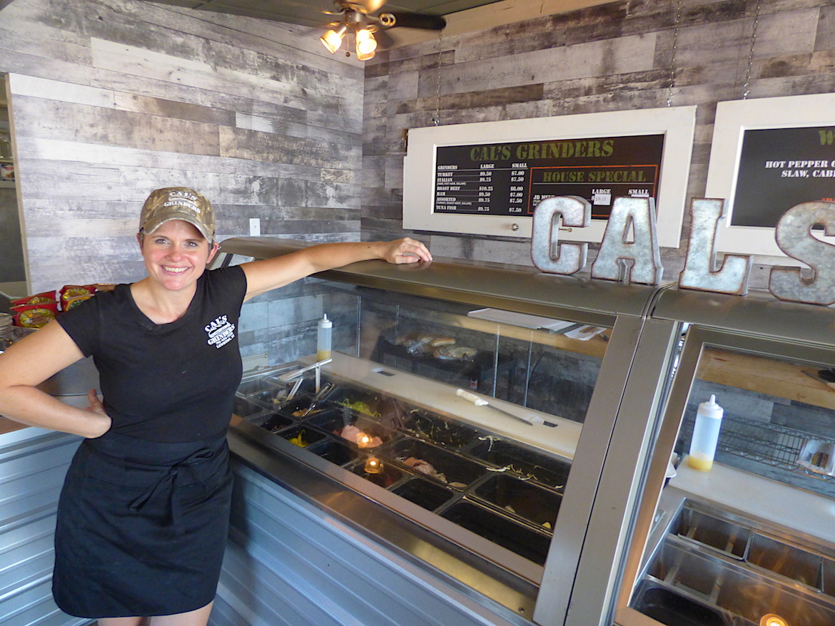 Lindy Dolan stands inside her new sub shop, Cal's Grinders, in the Village of Lewiston.