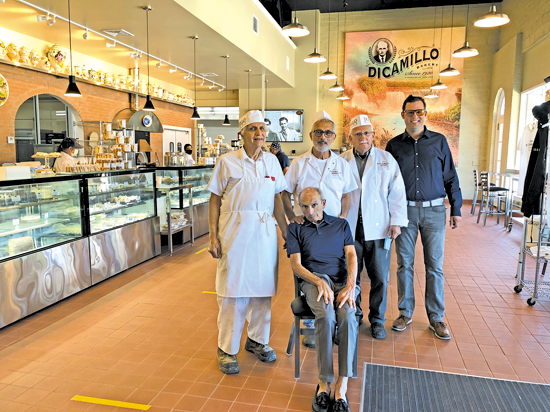 Pictured, from left: Tom DiCamillo, David DiCamillo (seated), Michael DiCamillo, Skip DiCamillo and Matthew DiCamillo. Tom, David, Michael and Skip are all brothers and are all third generation. Matthew is Skip's son, and a fourth-generation of the family business. His younger brother, Dan, baked bread earlier in the day and was not available for the photo.