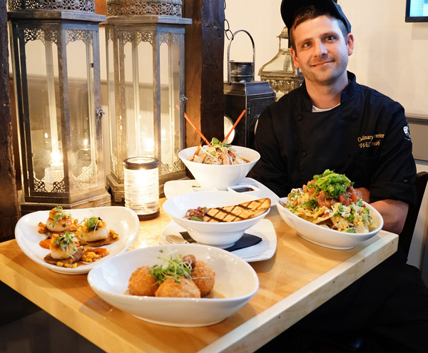 The Griffon's culinary director, Will Smith, shows a sample of the unique menu items offered in Lewiston. (Griffon photos by K&D Action Photo & Aerial Imaging)