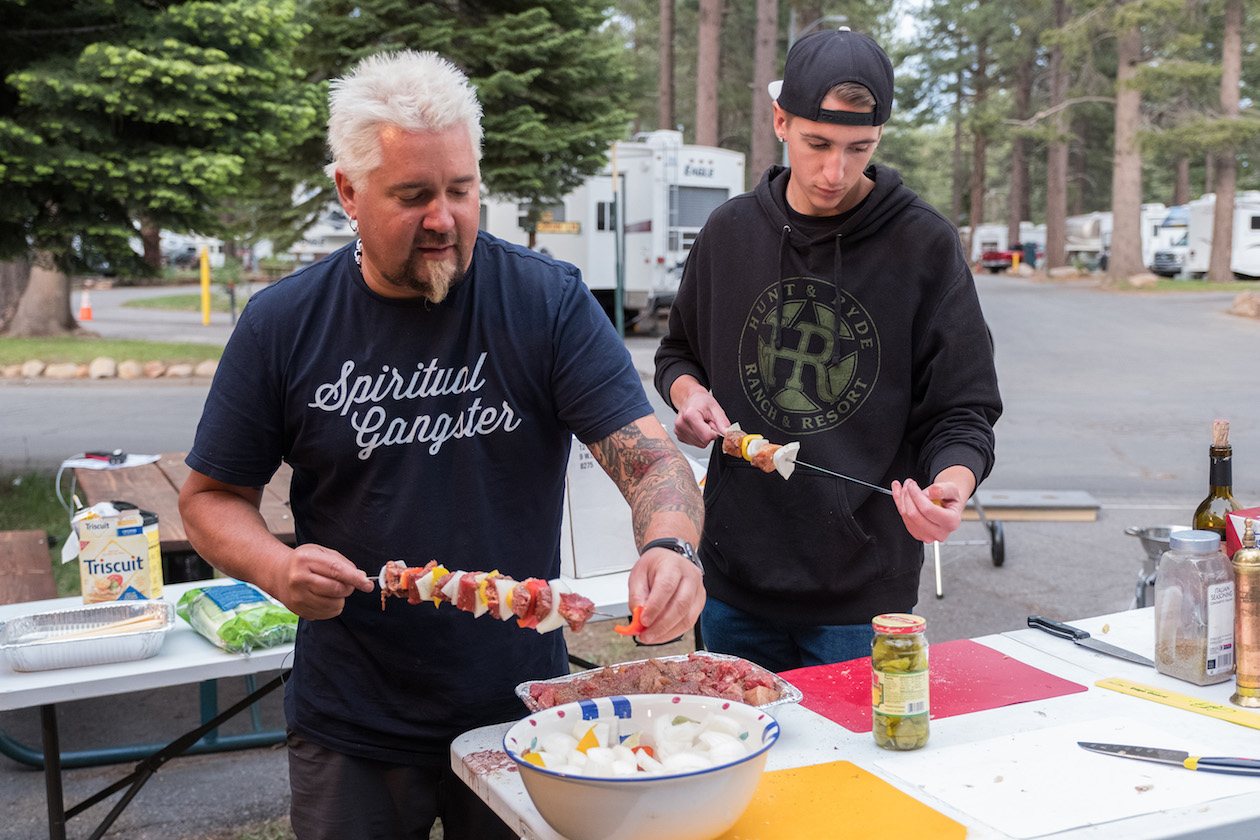 Guy and Hunter Fieri getting ready to grill on Food Network's `Guy's Family Road Trip.`