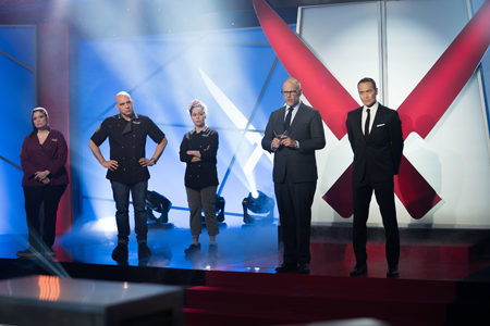 Alton Brown, `The Chairman.` with Iron Chefs Alex Guarnaschelli, Michael Symon and Stephanie Izard on Food Network's `Iron Chef Gauntlet.` (Food Network photo)