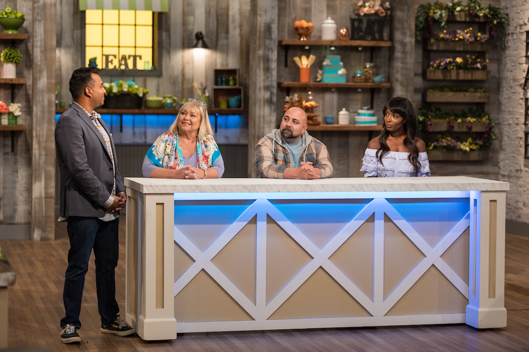 Ali Khan meets with the judges, Nancy Fuller, Duff Goldman and Lorraine Pascale, on Food Network's `Spring Baking Championship.` (Food Network photo)