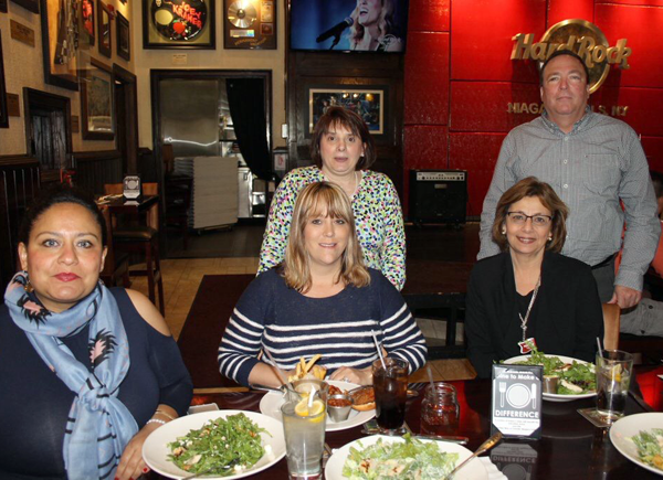 Pictured, from left, front row: Erika Kastel, United Way director of resource development; Pam Fahy administrative assistant; and Connie Brown, president. Back row: MaryKay Kirsch, financial associate; and Bill Jacobi, community services liaison. They're also pictured with the Hard Rock's Vinnie Bevilacqua.