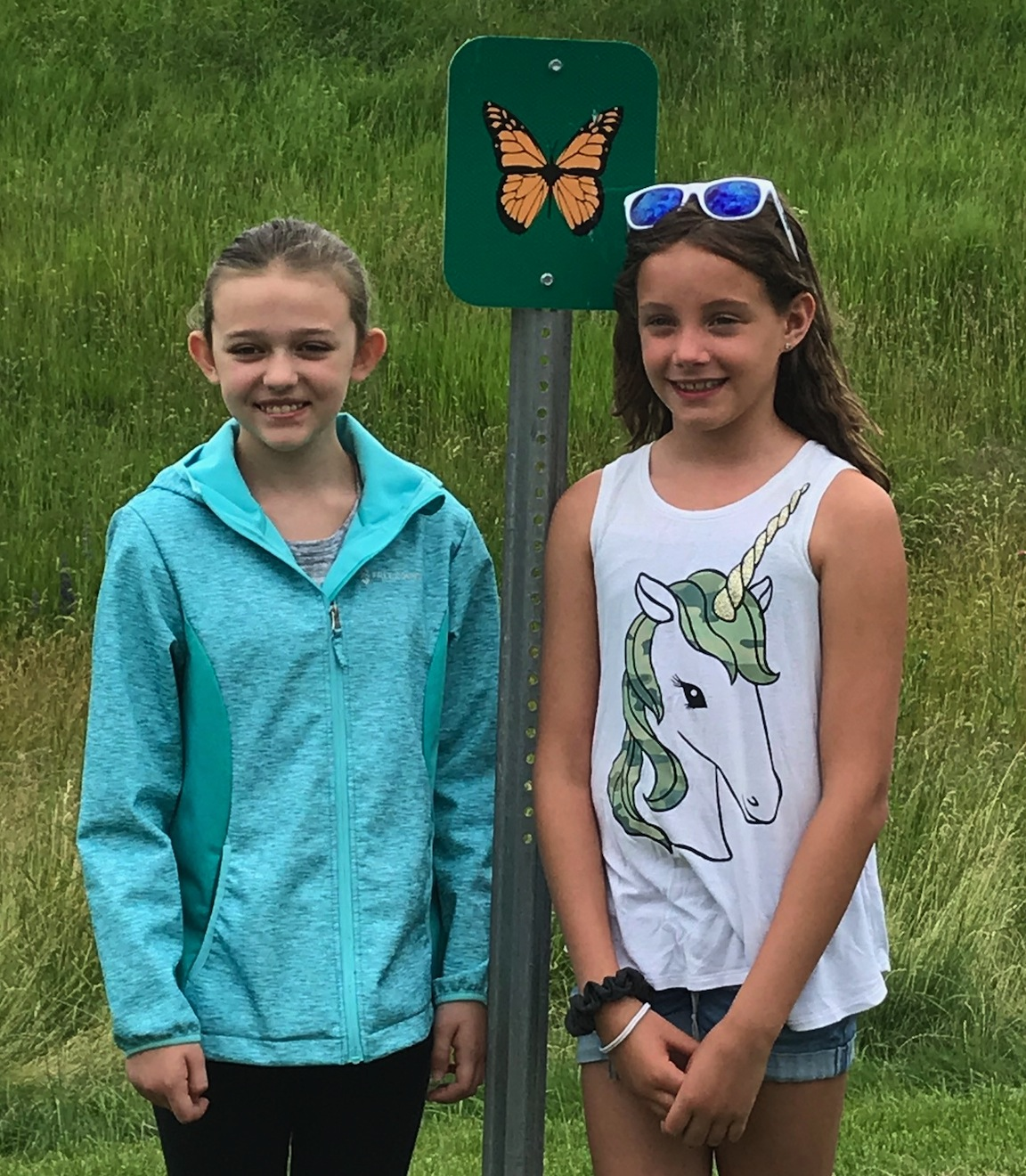 Olivia Doktor and Emily Thomas pose for a photo. The Errick Road Elementary duo wrote a letter to the New York State Department of Transportation advocating for the monarch butterfly population.