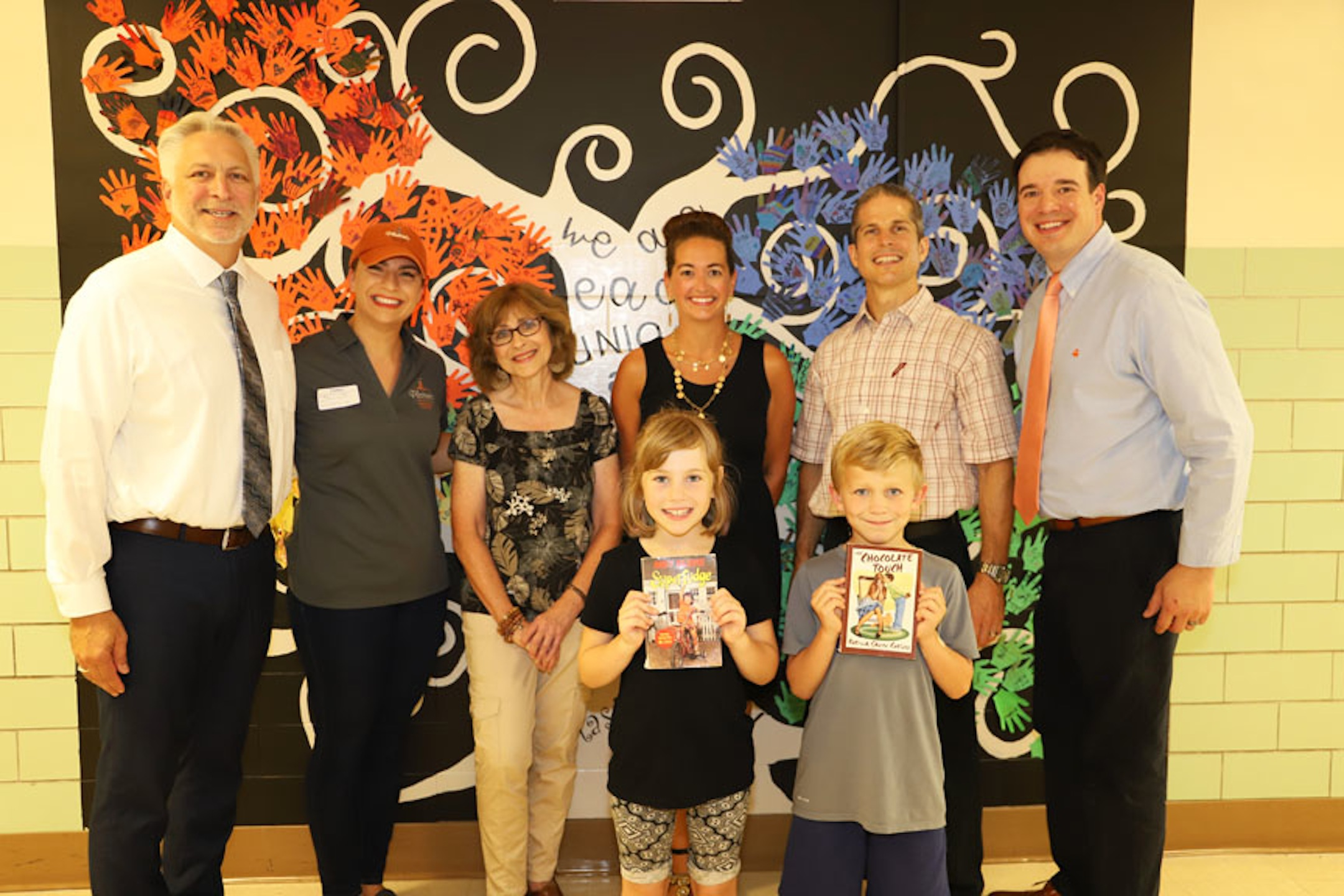From left, North Tonawanda Superintendent Greg Woytila; General Manager Platter's Chocolates Kelly DiGuiseppe; NT Librarian Marcia Bugyi; first grade teacher Jayne Davignon; Counselor Nathan Schelble; Ohio Street Principal Mike Hiller; and students Jeannette Hayley and Raymond Keidel.