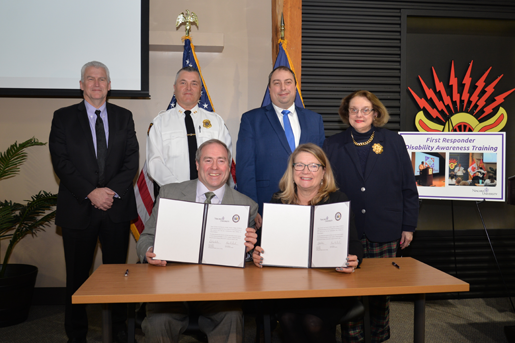 Seated, from left: Dave Whalen and Assemblywoman Karen McMahon; and standing, from left: Dr. Tim Ireland, Chief John Askey, Amherst Superintendent Brian Kulpa and Amherst Councilwoman Dr. Deborah Bucki.