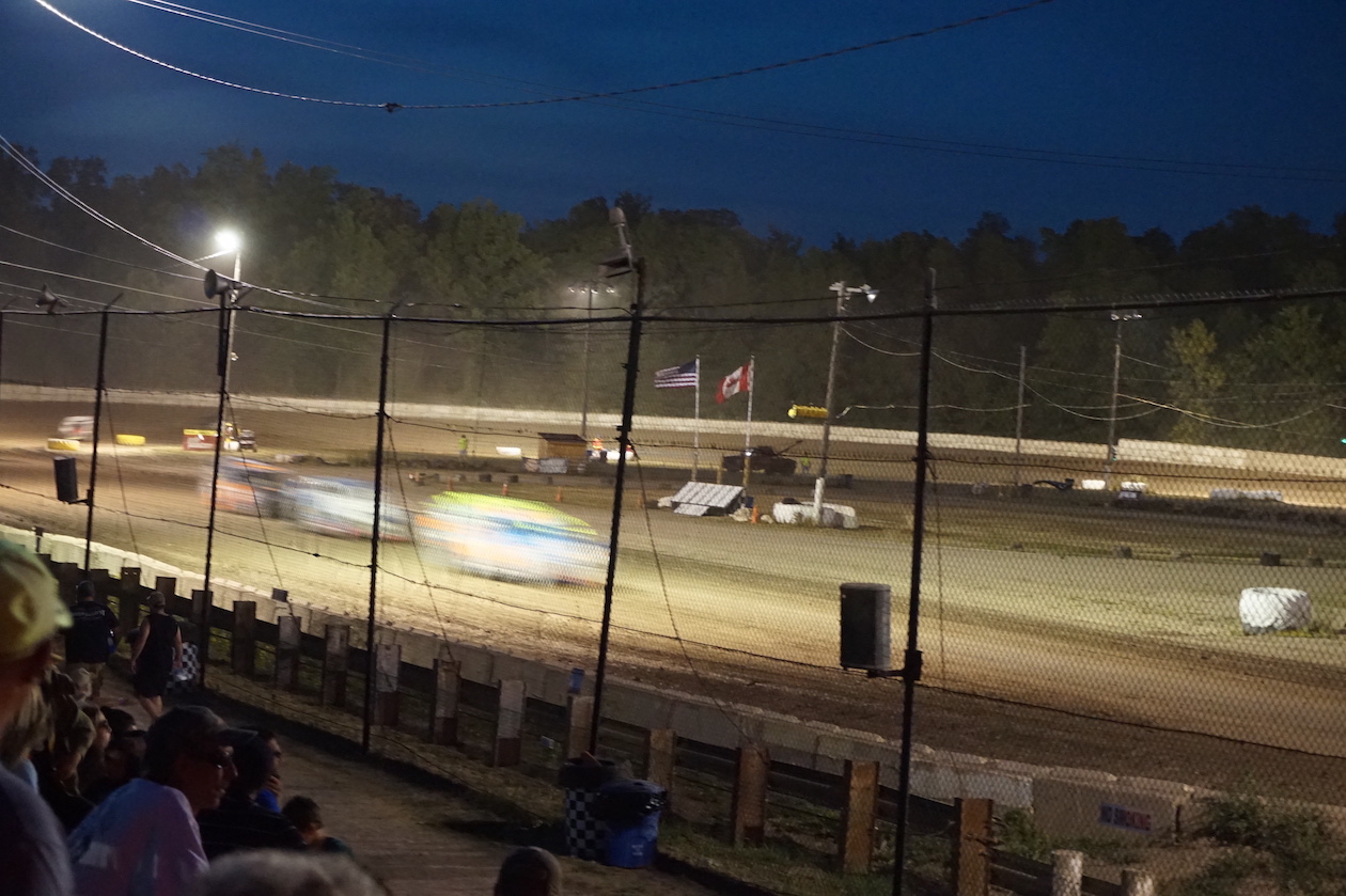 Ransomville Speedway image: Racing culture at tracks like the Ransomville Speedway includes special skills, techniques, customs and narratives - not only limited to drivers, but also the crew teams, track managers, admissions, race directors, scorers, and every other position at a track that enables races to happen. (Photo courtesy of the Castellani Art Museum of Niagara University)