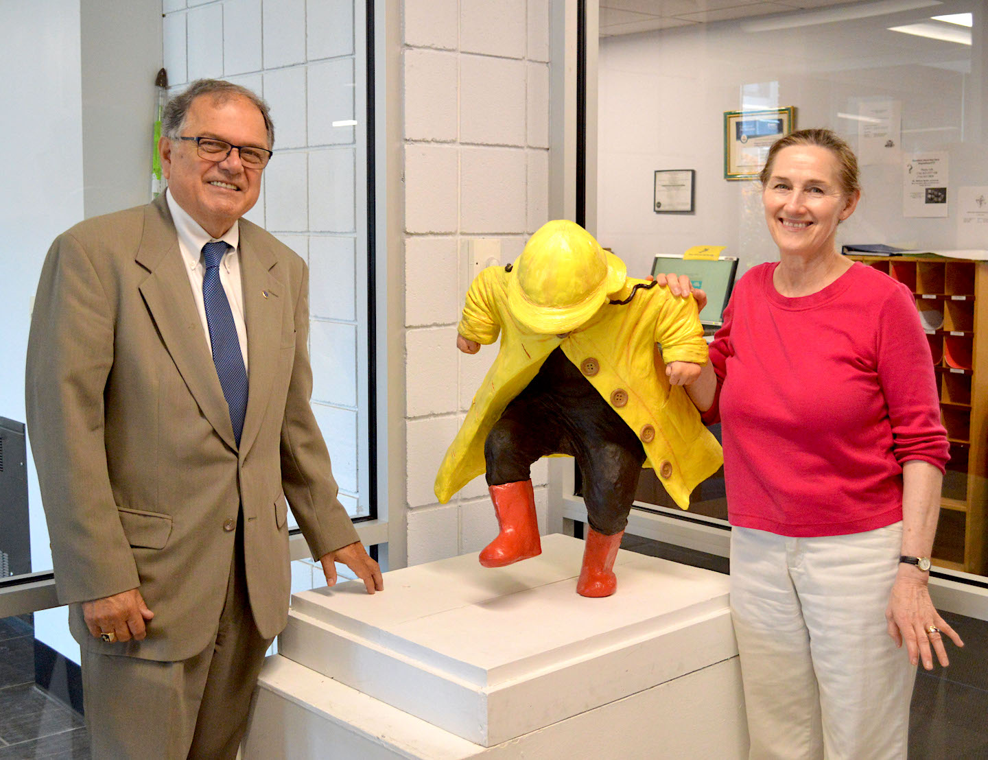 Pictured, from left: NCCC Interim President William J. Murabito, Ph.D., and artist Susan Geissler, '74, stand next to `Puddle Jumper.`