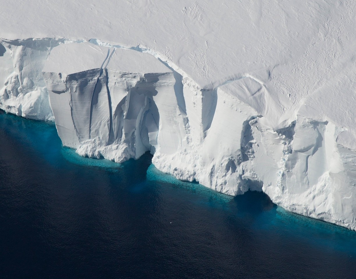 Ice shelves in Antarctica, such as the Getz Ice Shelf seen here, are sensitive to warming ocean temperatures. Ocean and atmospheric conditions are some of the drivers of ice sheet loss that scientists considered in a new study estimating additional global sea level rise by 2100. (Credit: Jeremy Harbeck / NASA; provided by the University at Buffalo)