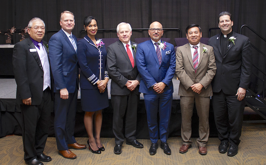 Dr. Tenpao Lee, dean of Niagara University's College of Business Administration, far left, and the Rev. James J. Maher, C.M., NU president, far right, presented awards to Robert Denning, president and CEO of Perry's Ice Cream; Sundra L. Ryce, president and CEO of SLR Contracting & Services Co.; Robert J. Travis, co-founder of Chiampou Travis Besaw & Kershner LLP; Jim Fashano, president of Alliance Advisory Group; and Minh Tran, founder of Tran Global International.