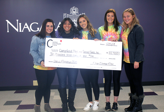 From left, Emily DiMaria, Camp Courage Crew vice president; Lisa Booz, WNY regional director at Camp Good Days and Special Times; Audrey Dunn, president; Madison Gottstein, treasurer; and Kelsey Schmidt, secretary.