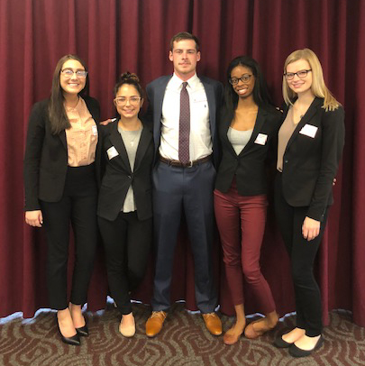 From left: Madeline Dallessandro, Baillie Latour, Thomas Stedman, DaShawna Levert and Amy Breslin, winners of the Karma Wellness Water case competition.