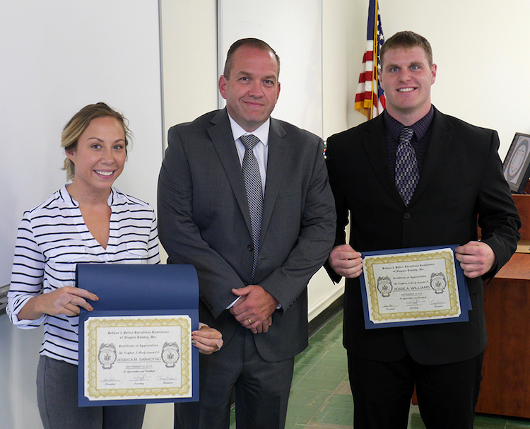 Niagara County Undersheriff Michael J. Filicetti, center, presented scholarships to Niagara County Law Enforcement Academy students Jessica Saraceno and Jesse Williams.