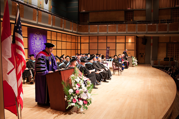 The Rev. James J. Maher, C.M., president of Niagara University, addresses the new teacher graduates during Tuesday night's commencement at the Toronto Centre for the Arts.