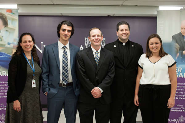 Pictured at the unveiling of the Rose Bente Lee Ostapenko Center for Ethics in Medicine and Healthcare at Niagara University were, from left, Bernadette Franjoine, vice president for mission integration at Mount St. Mary's Hospital; Adam Siedlecki, a 2017 NU graduate now attending medical school at the University at Buffalo; Dr. James Delaney, the Ostapenko Endowed Chair of Professional Ethics; the Rev. James J. Maher, C.M., Niagara president; and Britteny Purcell, an NU biology major.