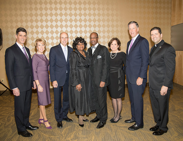 Pictured at Niagara University's 2017 President's Dinner are, from left, Larry A. Montani, Mary Montani, William G. Gisel Jr., Pastor JoAnne Scott, Bishop Jesse J. Scott, Mary Helen Holzschuh, Jeffrey R. Holzschuh and the Rev. James J. Maher, C.M.