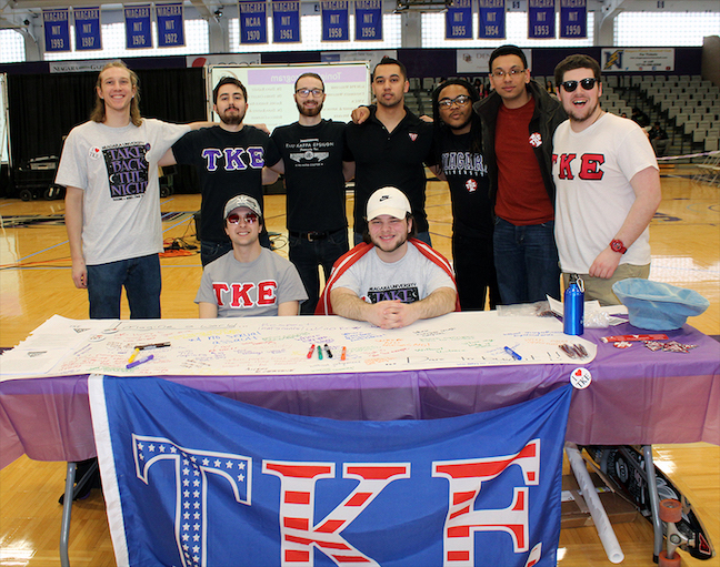 Members of Tau Kappa Epsilon show their support to end sexual, relationship and domestic violence during Niagara University's `Take Back the Night` event.