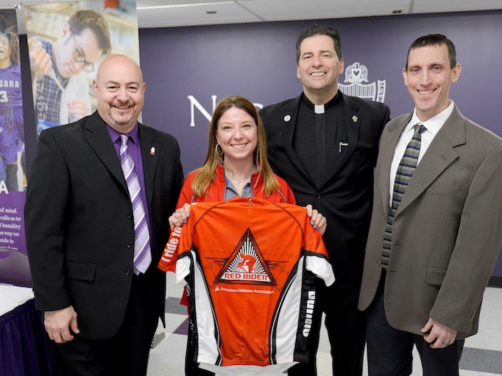 From left, Bob Russell, executive director at American Diabetes Association; Lisa Centrone, red rider; Rev. James J. Maher, C.M., president, Niagara University; Bill Newton, assistant director of campus activities and NU team captain.