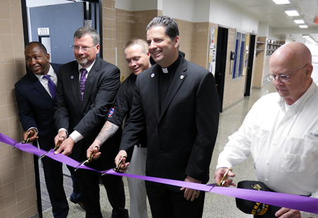 Cutting the ribbon on the new veterans lounge at Niagara University: Jarrad Turner, Niagara University Institutional Advancement; Robert Healy, director of veteran services; student-veteran John Martek; Rev. James J. Maher, C.M., president of Niagara University; and Ed Lynch, NU Class of 1965.