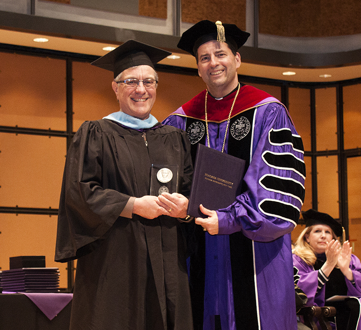 Longtime Ontario educator Robert Cutting received the Ozanam Medal from the Rev. James J. Maher, C.M., president of Niagara University, on Wednesday evening at the Toronto Centre for the Arts.