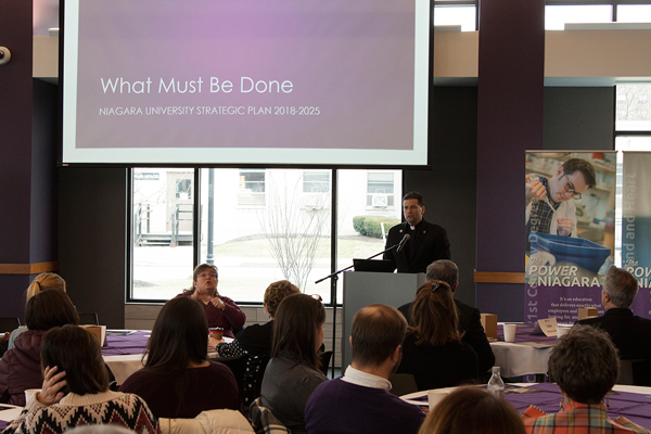 The Rev. James J. Maher, C.M., president of Niagara University, discusses the institution's 2018-25 strategic plan during a community meeting on Thursday afternoon.