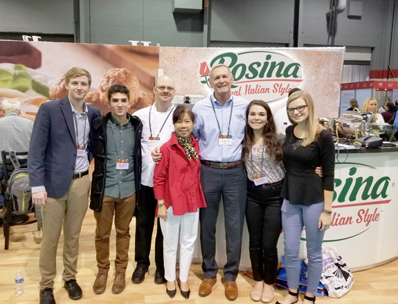 Niagara University students Ryan DeCory, Amy Breslin, Shaun Carvalho and Olivia Copeland are shown with Dr. Peggy Choong and executives from Rosina at the Private Label Manufacturing Association Trade Show.